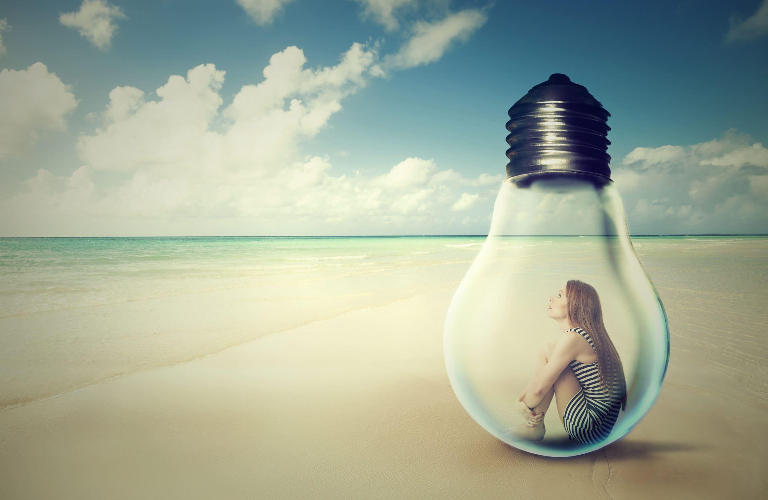 Woman on beach in light bulb